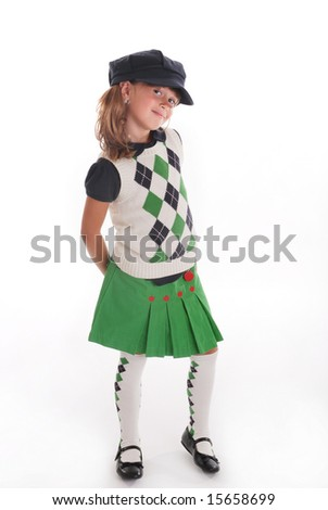 A cute young girl wearing a  back to school outfit - stock photo