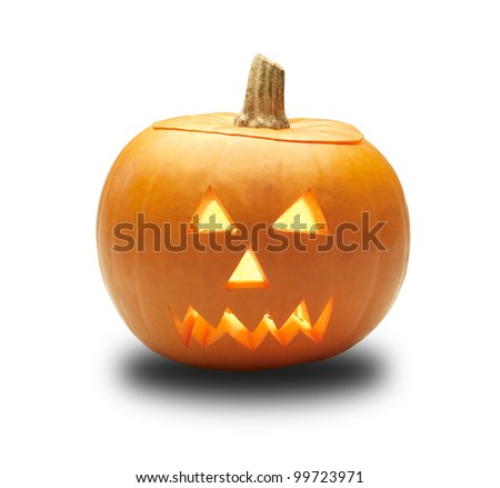 a cutout halloween lit glowing pumpkin turnip lantern isolated on a white background with clipping path - stock photo