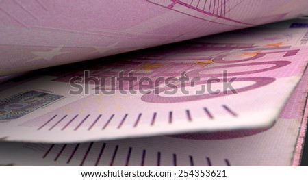 A 3D rendering of a macro close-up view showing the detail in between two separated euro banknotes - stock photo