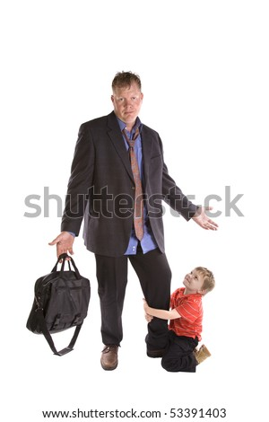 A dad frustrated with his son and needs to go to work. - stock photo