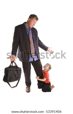 A dad needs to go to work and his child won't let him go. - stock photo