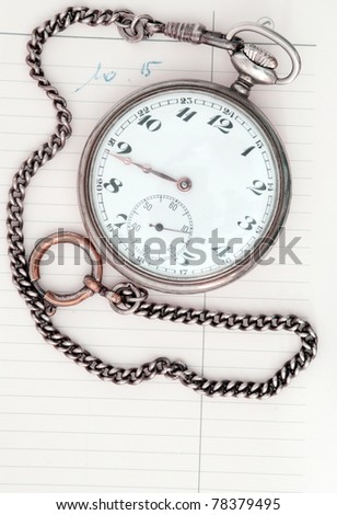 A daily planner with a pocket watch