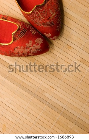 A dainty pair of Japanese slippers wait prepared for the owner to slip into them for the evening. - stock photo