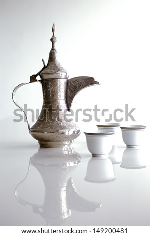 A dallah is a metal pot with a long spout designed specifically for making Arabic coffee - stock photo