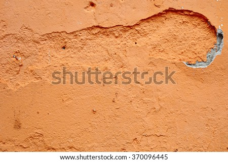 A damaged orange color concrete walls for textural background.  - stock photo