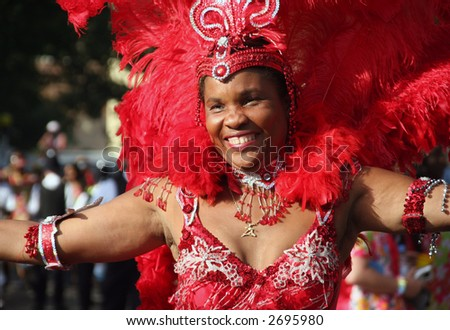 a dancer from one of the processions at the notting hill carnival 2006 london - stock photo