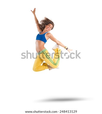 A dancer jumps in a zumba choreography - stock photo