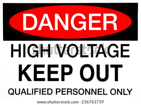 A Danger, High Voltage safety sign in bold lettering. - stock photo