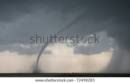 A dangerous tornado lurks on the horizon - stock photo
