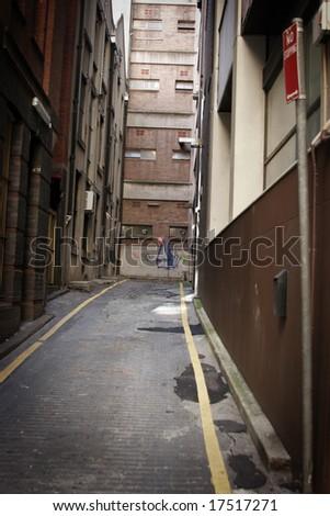 A dark alleyway - stock photo