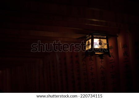a dark lantern in a Japanese temple - stock photo