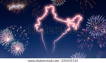 A dark night sky with a sparkling red firecracker in the shape of India composed into.(series) - stock photo