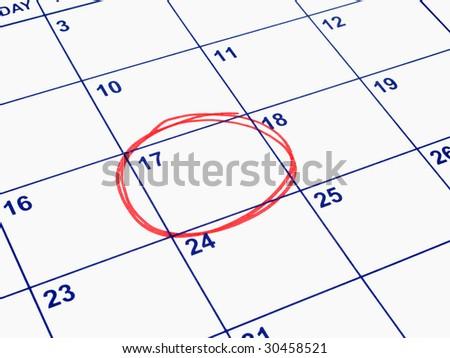 A date circled on a calendar. - stock photo