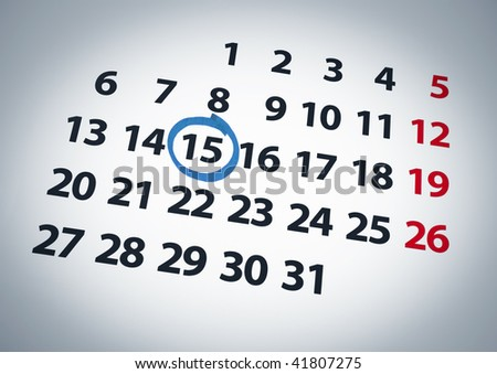 A date circled on a 15th day of a calendar with blue ink. - stock photo