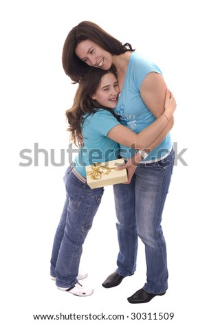a daughter kissing and giving her mother a present - stock photo
