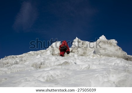 A day in the sun, a child climbs up on top. - stock photo