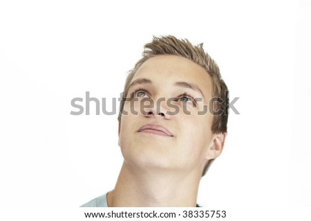 A daydreaming young man on a white background - stock photo