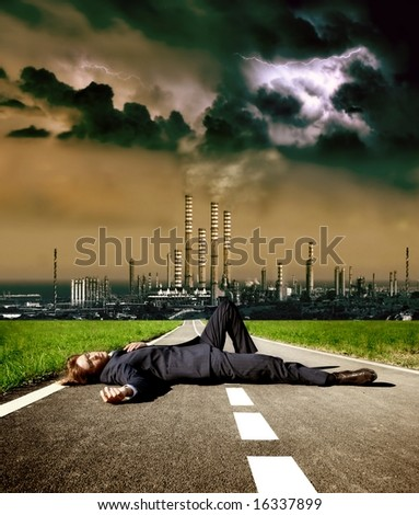 a dead man on the street and a factory - stock photo