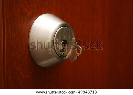 A deadlocked door with a key. - stock photo