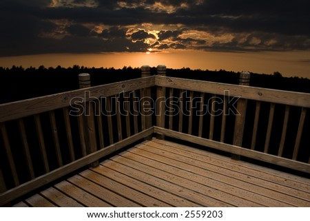 a deck against a sunset background - stock photo
