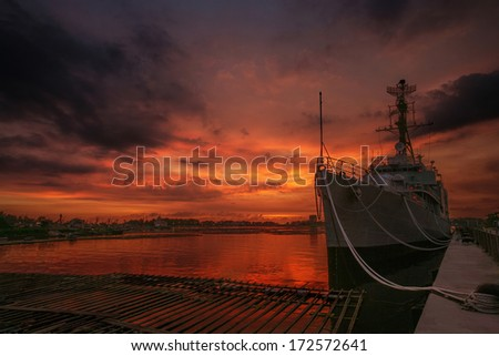 A decommissioned destroyer docks in a fishing port in Anping harbor as a exhibition .  - stock photo
