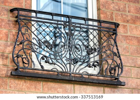 a decorative balcony a wrought metal - stock photo