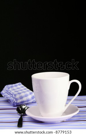 A decorative blue table set for a coffee break - stock photo