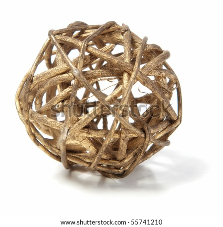 A decorative wicker wooden ball isolated against a white background. - stock photo