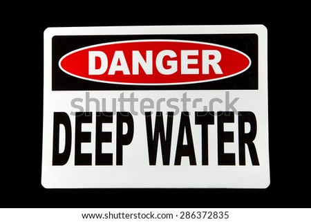 A deep water danger sign against a black background - stock photo