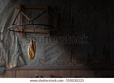 A deflated punching bag from the past. - stock photo