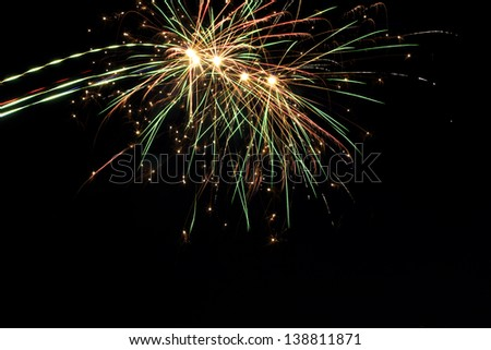 A delicate burst of fireworks in the night sky - stock photo