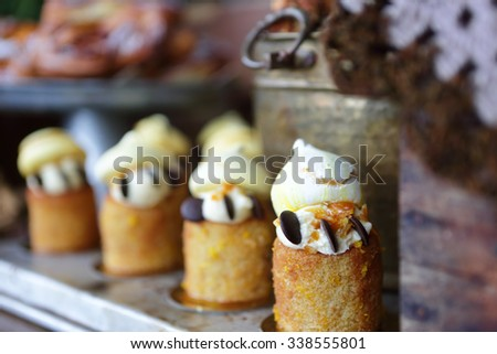 A delicious array of scrumptious cakes and pastries on display at The Grounds Cafe - stock photo