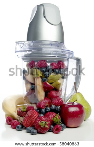 A delicious cold Fruit Smoothie or daiquiri in a blender - stock photo