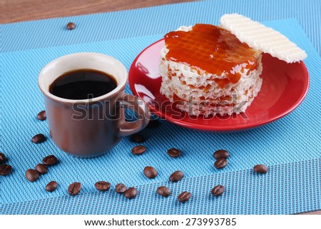 A delicious dessert. Lunch, snack. Cup of coffee on the table. A Cup of espresso. Refined sugar, coffee beans and waffles with jam. Waffles, covered in apricot jam.  - stock photo