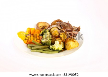 A delicious English roast dinner with all the trimmings, from lamb, gravy and Yorkshire puddings. English roast dinner. - stock photo