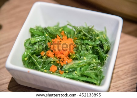 A delicious fresh seaweed salad blurry background and select focus - stock photo