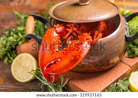 A delicious freshly boiled lobster in the pot - stock photo