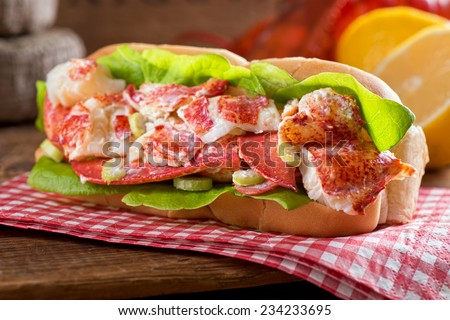 A delicious freshly made lobster roll with lobster, lemon, celery, and mayonnaise. - stock photo