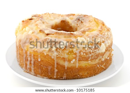 A delicious lemon pound cake isolated on a white background.