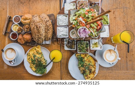 A delicious Mediterranean breakfast in the port of Tel-Aviv, Israel. - stock photo