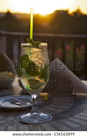 A delicious Mojito cocktail on a hotel terrace at sunset - stock photo
