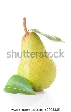 A delicious, organic and ripe pear with leaves isolated - stock photo