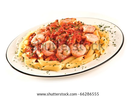 A delicious Penne Pasta & Shrimp meal on white - stock photo