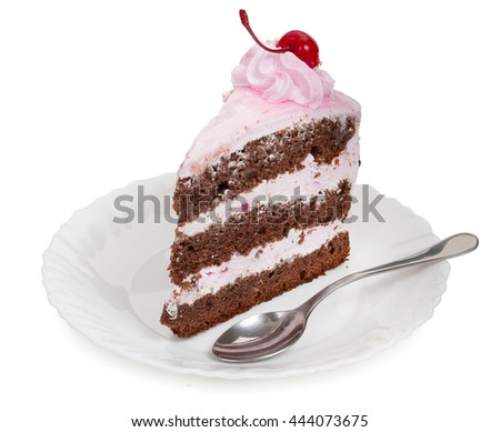 A delicious piece of chocolate cake with cherry cream and canned cherries on a white plate with a teaspoon, close-up. - stock photo