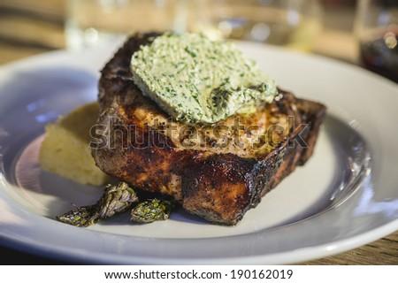 a delicious pork chop at a restaurant. - stock photo