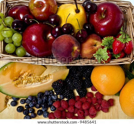 A delicious selection of fruit overflowing from a basket - stock photo