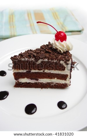 A delicious slice of Black Forrest Cake. On a plate and ready to eat - stock photo