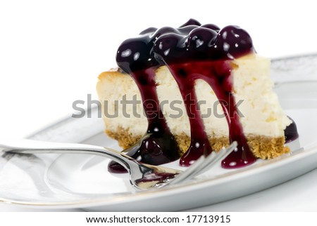 A delicious slice of cheesecake with fruit topping. - stock photo