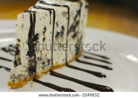 A delicious slice of chocolate cookie cheesecake - stock photo