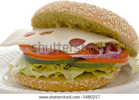 delicious swiss cheese and veggie bagel sandwich with a cilantro ...